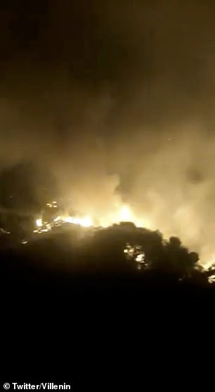 Video showed the fires raging into the night near the Costa del Sol resort town of Estepona