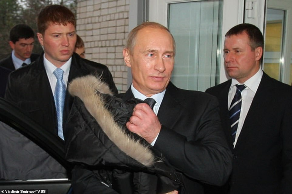 Some believe Putin was grooming Zinichev (pictured right with Putin in 2010) - like him, once a KGB operative - as his eventual successor