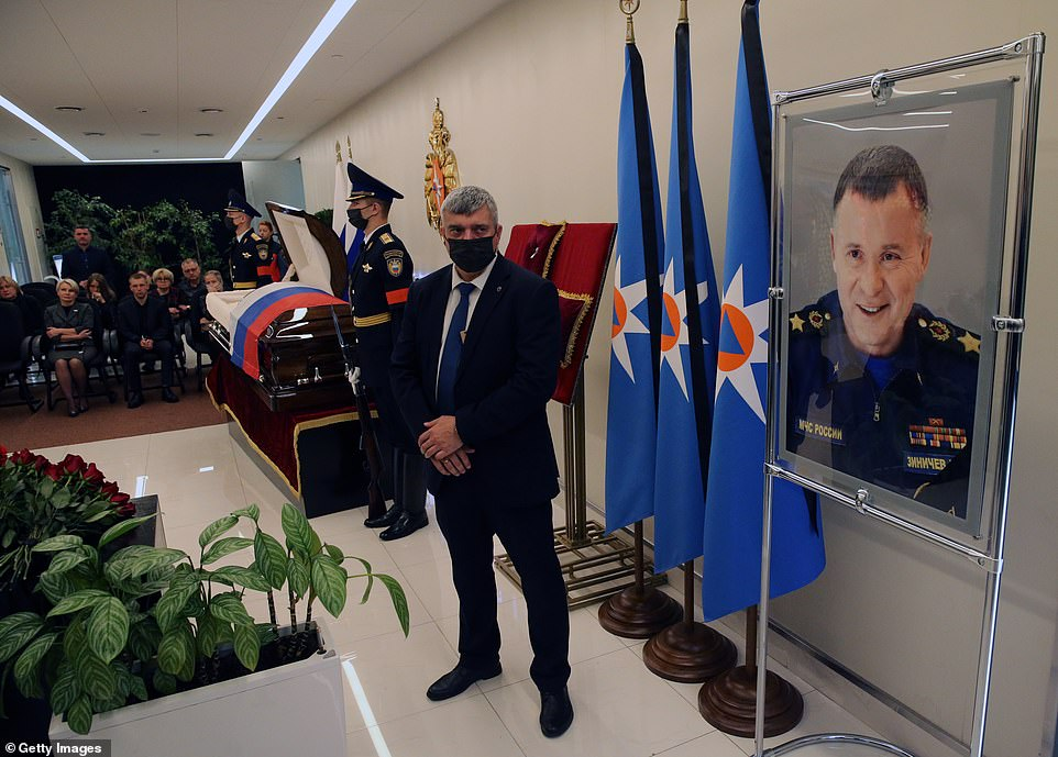 Mourners attend at funeral of Russian emergencies minister Yevgeny Zinichev in Moscow today