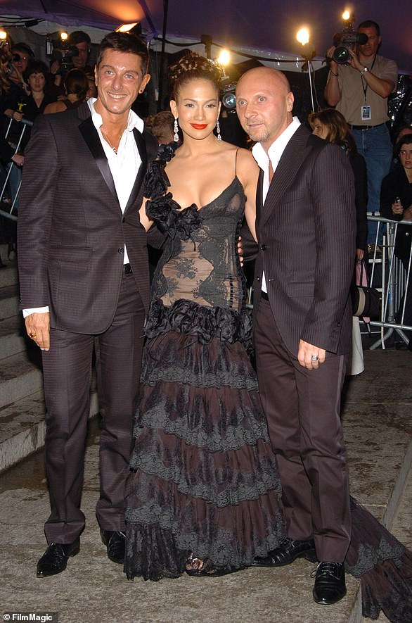 In 2004: The diva was in a black lace tiered dress when she posed with Stefano Gabbana and Domenico Dolce at the event