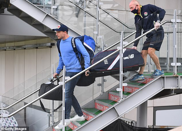 England player Jos Buttler leaves the dressing room with his kit with the help of a member of staff