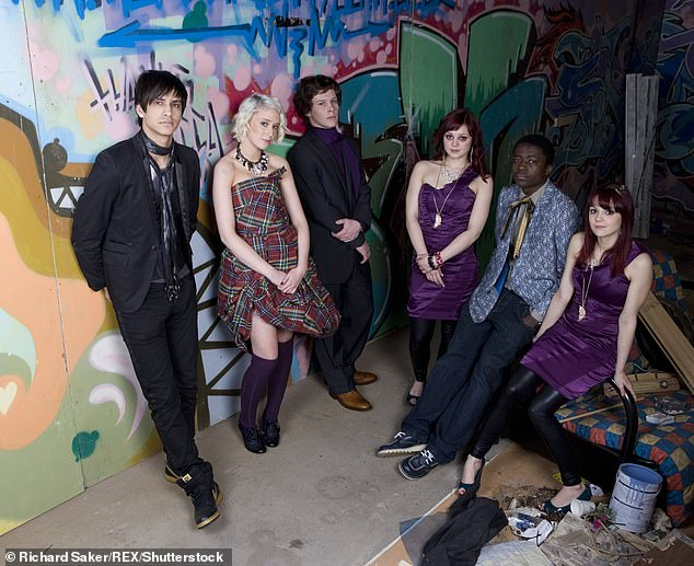 The twin sisters are pictured with the Skins cast, includingLuke Pasqualino, in 2009