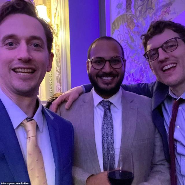 'A beautiful day': Comedian John appeared to be enjoying himself alongside fellow funny man Elis James (pictured far R)