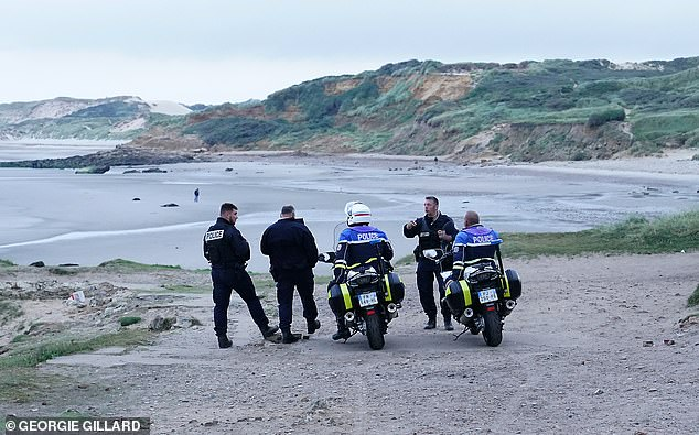 Police patrol the stretch of beach for migrants between Wimereux and Audresselles, Northern France