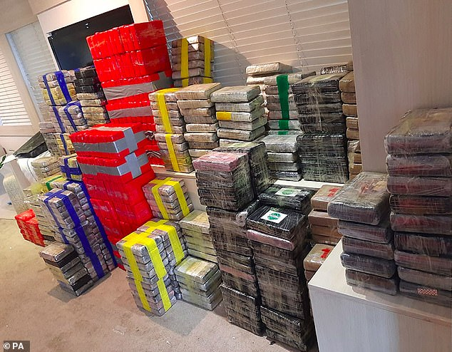 The Jamaican-flagged vessel was carrying more than two tons of cocaine with a street value of around £160million (Pictured: Part of the cocaine haul)