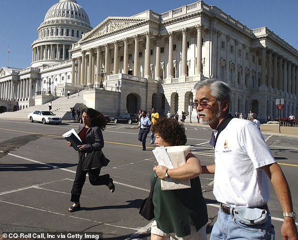 People run from the Capitol Building after Flight 77 crashed into the Pentagon on the morning of September 11, 2001. Biden arrived at Union Station after the Pentagon attack and an officer wouldn't allow him to enter the Capitol