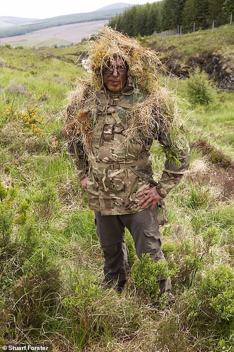 Trigger happy: The Mail on Sunday's Stuart Forster in camouflage