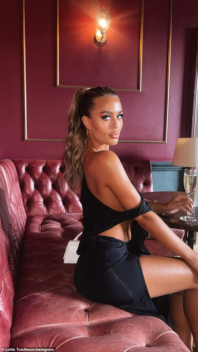 Gorgeous: Posing for Instagram photos at the bar of the swanky reception, Lottie - who is the sister of One Direction star Louis - showed off her incredible figure in a revealing black dress