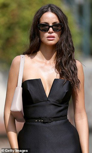 Sizzling: The Brazilian model wore a small stone handbag on her shoulder
