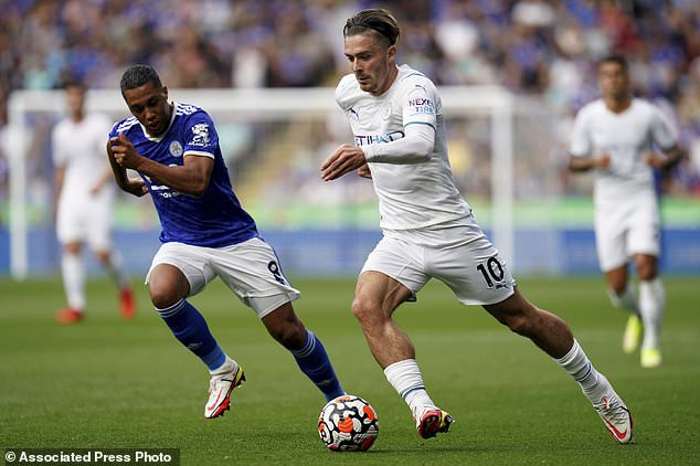 Manchester City's Jack Grealish, right, and Leicester City's Youri Tielemans in action during their English Premier League soccer match at The King Power Stadium, Leicester, England, Saturday, Sept. 11, 2021. (Nick Potts/PA via AP)