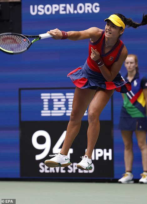 Raducanuleaping into the air to fire off a serve