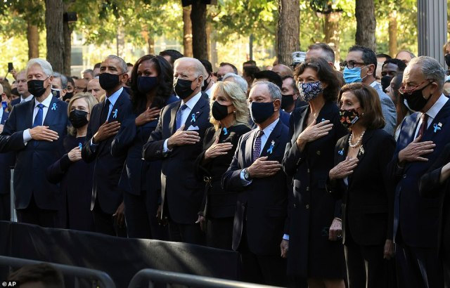 His visit to the precinct came after Biden was joined by former Presidents Bill Clinton and Barack Obama at the official 9/11 memorial ceremony at Ground Zero Saturday morning (pictured above)