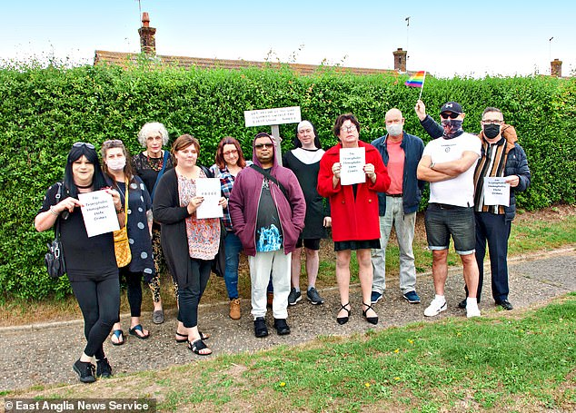 Pride protesters near the home of transgender woman Mary Carberry who has been allowing a club to hold men-only sex parties at her house,