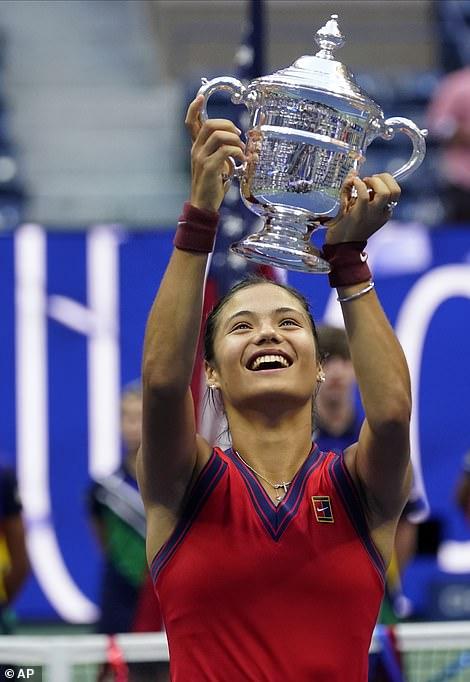 Raducanu celebrates with the trophy