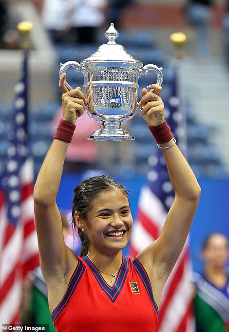 Raducanu holds the US Open women's trophy aloft after beating the Canadian 6-4, 6-3 at the Arthur Ashe Stadium in New York