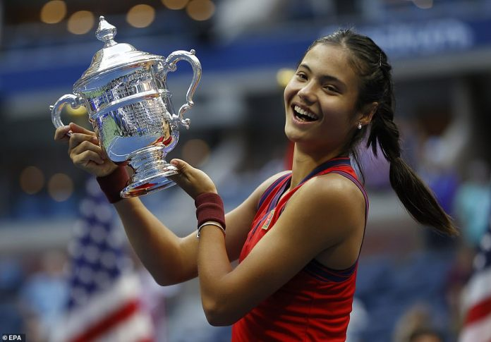 British Grand Slam winner Raducanu - Raducanu looks overjoyed as she holds her first major trophy aloft.Speaking afterwards, Raducanu appeared totally stunned, saying: 'I'm still just so shocked, still in the moment. I can't believe I came through that last service game. It honestly means absolutely everything to hold this trophy. I just don't want to let go'