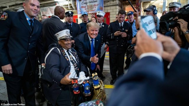 Trump posed for photos with a group of cops and held a brief question and answer session