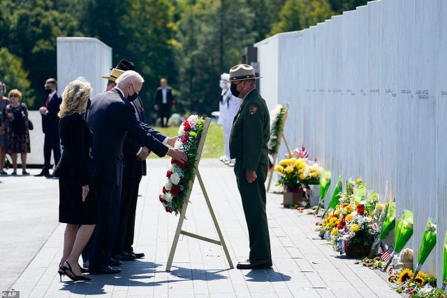 President Joe Biden and First Lady Jill Biden lay a wreath at the Wall of Names during a visit to the Flight 93 National Memorial in Shanksville