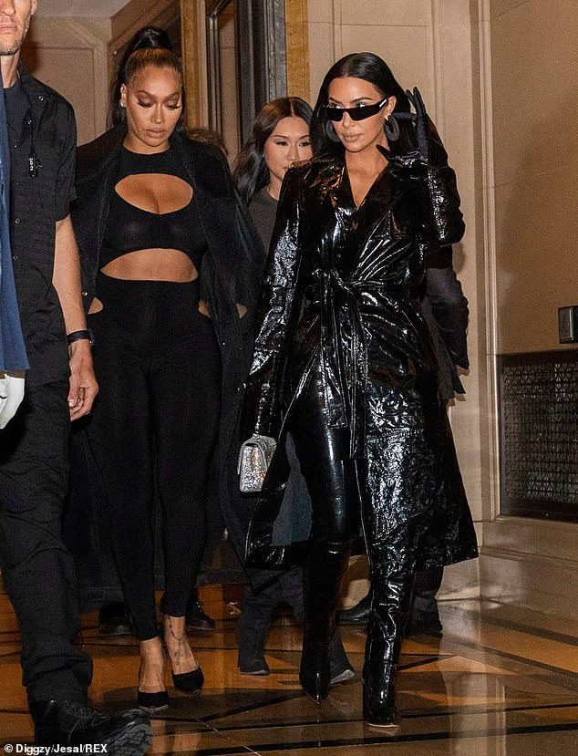 Bestie: Kardashian was first spotted exiting her hotel with pal La La Anthony, 39 (left)