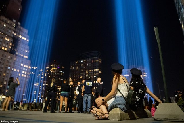 People visit the Tribute In Lights in Lower Manhattan on September 11, 2021 in New York City