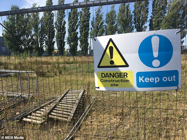 The playing field was fenced off after it was left with rubble, craters and dangerous materials