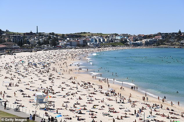 Mark McGowan has slammed self-absorbed Sydneysiders saying they don't realise there's an Australia outside of the Harbour City. Pictured: Sydney's Bondi Beach is packed on Sunday