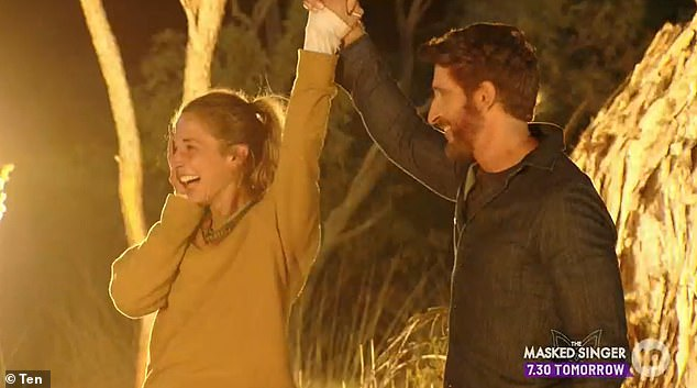 Winner: Leake was crowned the sole survivor on Australian Survivor: Brains v Brawn during Sunday night's grand finale. Hayley is pictured with hostJonathan LaPaglia