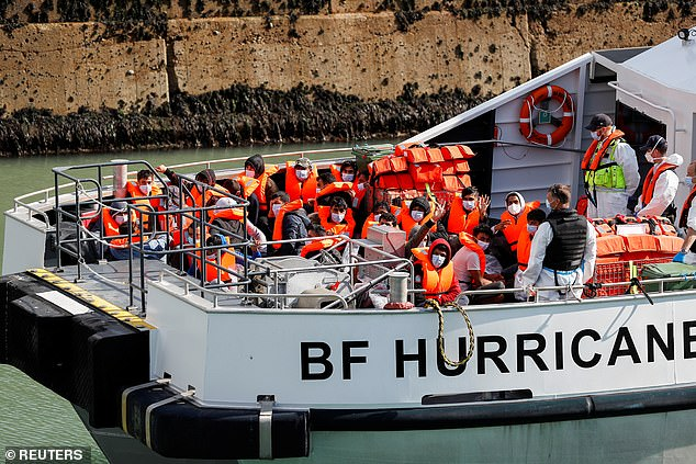 Migrants are rescued from the English Channel and brought into Dover harbour in Kent by Border Force officials on Sunday, September 12