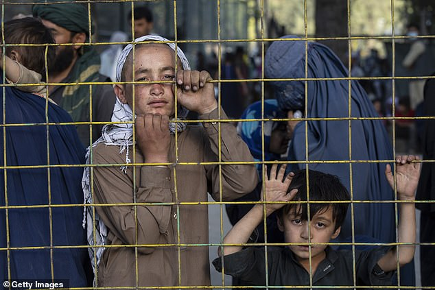 The UK and Canada have promised to grant safe haven to 20,000 refugees looking to escape the new regime, while Australia is so far accepting 3,000 (pictured, refugees in Kabul)