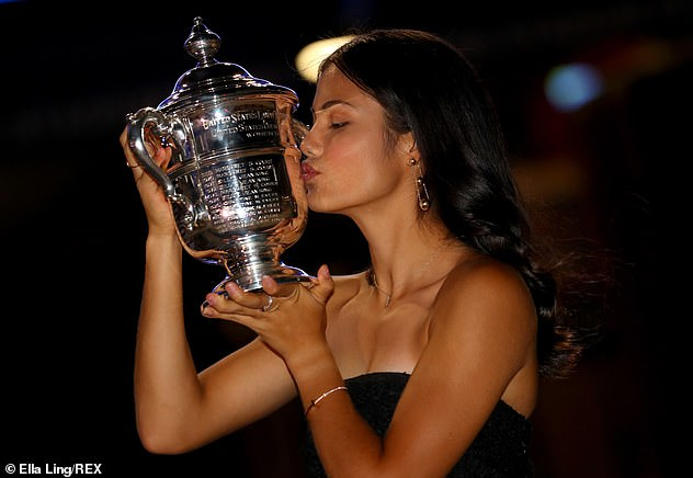 The tennis star was seen kissing her trophy after beating 19-year-old Canadian rival Leylah Fernandez in front of an enthralled Arthur Ashe Stadium in Flushing Meadows