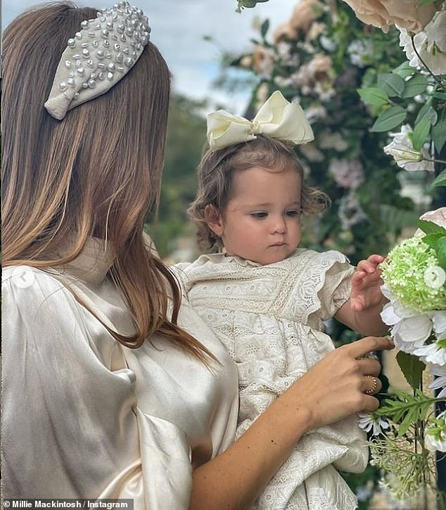 Matching: Both Millie and her one-year-old daughter wore pretty headwear