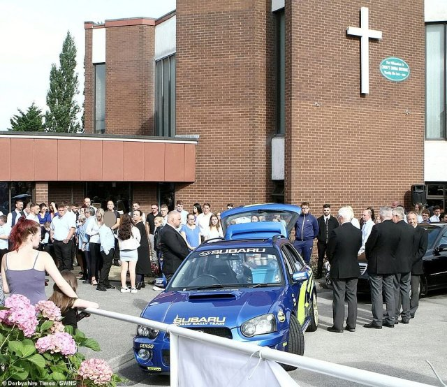 Hundreds of mourners lined the streets for the funeral of the teenage boy who was described as 'a hero to his family, to his friends, to this community'