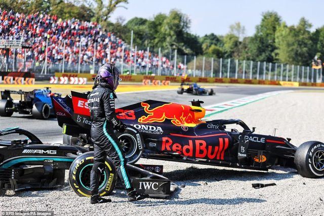 Hamilton took a moment to inspect the respective damage suffered by the two cars as he and Verstappen crashed out