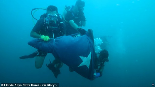 Divers with the Florida Keys National Marine Sanctuary unfurled a US flag on Saturday