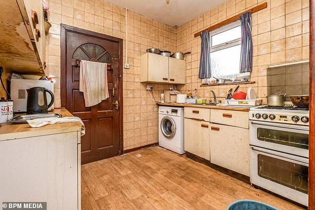 The dated property, which was put on the market just this week, comes with a back garden, upstairs bathroom, dining room, kitchen, living room and three bedrooms