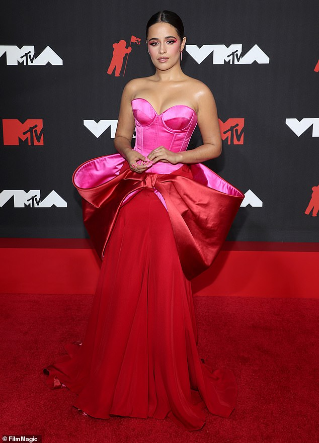 Colorful:The top portion of the dress was a pink corset with a sweetheart neck and the bottom was flowing red satin which fell all the way to the ground