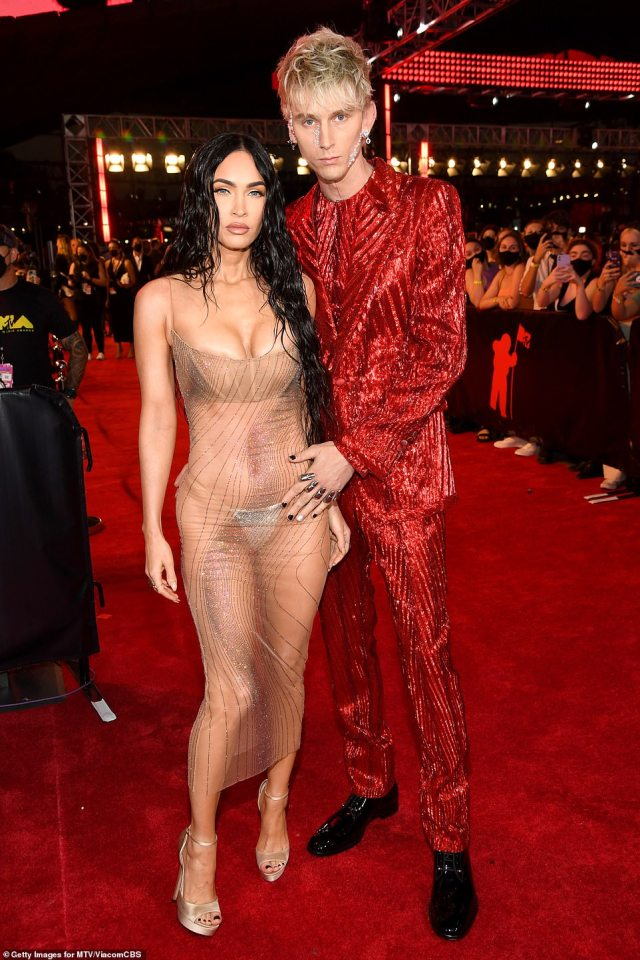 Double trouble: Mega left little to the imagination while on the red carpet with boyfriend