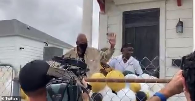 Brooks waves to the small crowd that reunited in front of his home in New Orleans to celebrate his birthday