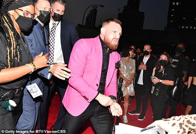 Enough is enough! Both MGK, 31, and McGregor, 33, were ushered away from the scene and went inside the venue