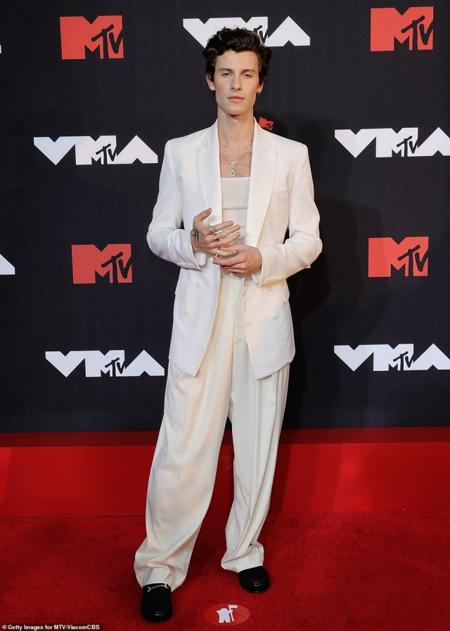 Suits you! Shawn Mendes embraced a retro silhouette wearing a baggy cream suit over a white tank top