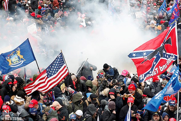 Tear gas is released into a crowd of protesters during clashes with Capitol police at a rally to contest the certification of the 2020 U.S. presidential election results by the US Congress