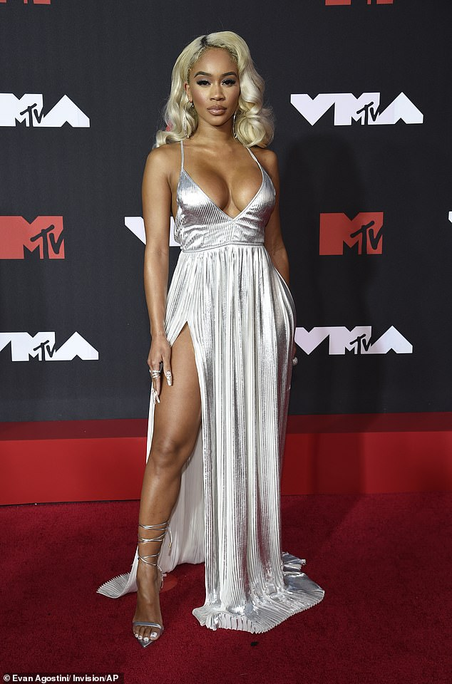 All eyes on her: The 28-year-old rapper - real name Diamonté Quiava Valentin Harper -donned a very low-cut silver dress featuring a thigh-high split at the star-studded event