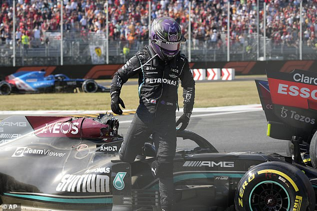 The damage inflicted on Hamilton's car just inches behind his head is visible as he steps out