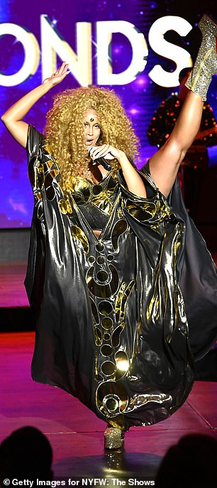 Kicking it up: Lion Babe was seen in a mystical looking cape
