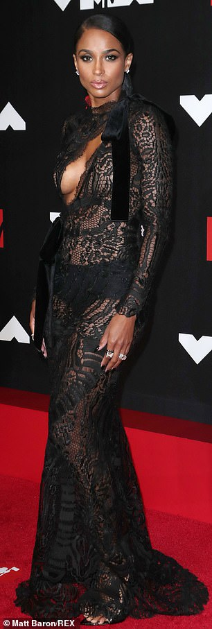 Gorgeous: She teamed the stunning frock which gave a glimpse of her undergarments with a pair of black heels