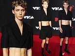 Troye Sivan shows off his incredible abs in acropped black jacket as he attends theVMAs