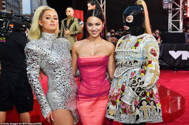 Trio: Paris Hilton and Olivia Rodrigo posed with Kim Petras, who wore a BDSM-inspired mask with a Richard Quinn dress that looked plucked from the 17th century