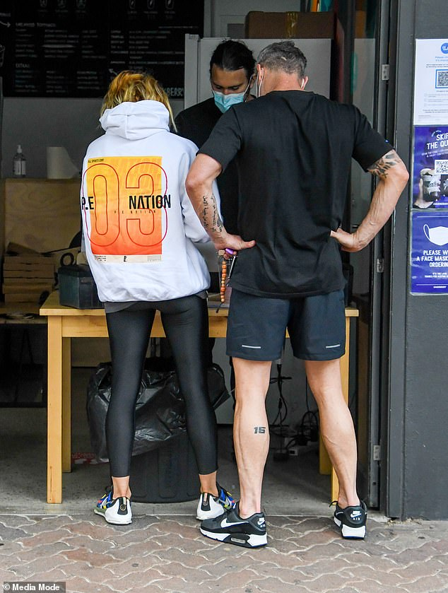 Lunchtime: After placing their order at a makeshift counter at the entrance to the cafe, Pip, 41, and Michael then stood outside on the footpath as they waited for their meals