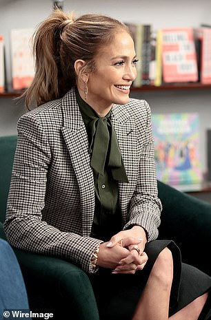 Attentive: J-Lo sported a smile on her face as she chatted with the other attendees
