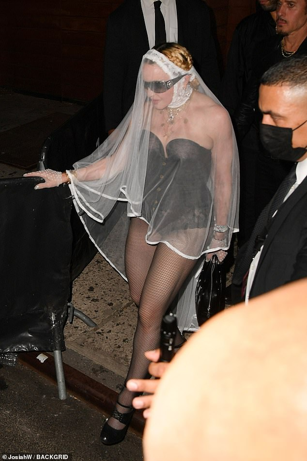 Stepping out:The 63-year-old chanteuse went for an even quirkier vibe than she did on stage, donning a white wedding veil with a sexy black leather bodysuit